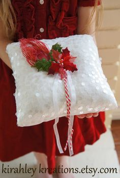 SANTA BABY -- Christmas Holiday, Candy Cane, Red Peacock Feather, Velvet Holly Berries, White Snow, Winter Wedding Ring Bearer Pillow. $36.00, via Etsy.