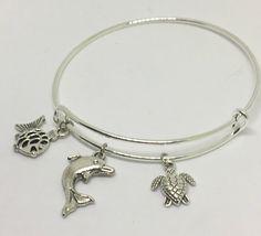 Sea life charm bangle bracelet by Pinkarrowheadranch on Etsy https://www.etsy.com/listing/525132419/sea-life-charm-bangle-bracelet