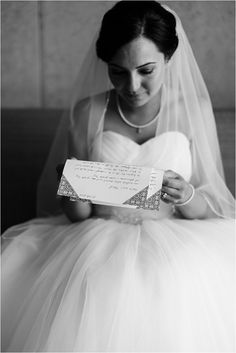 bride reading a love letter, wedding at the factory hotel münster, photographed by jennifer hejna