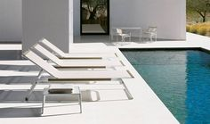 """'MIRTO' A CHAISE LOUNGE WITH ADJUSTABLE BACK, INSTEAD OF WHEELS, IT HAS TWO SMALL, VERY DISCREET ROLLERS THAT ALLOW IT TO MOVE. THE FOLDING SMALL ARMCHAIR IS THE RESULT OF A DESIGN DEVELOPMENT STARTING FROM THE CLASSIC """"FILM-DIRECTOR CHAIR"""" TYPOLOGY. THE INTRODUCTION OF SEATS, DINING TABLES AND SMALL TABLE MAKES MIRTO A COMPLETE OUTDOOR FURNITURE COLLECTION. THE MESH AND METAL PARTS ARE FINISHED IN TWO COLOURS, WHITE AND TORTORA. FOR FURNISHINGS OF A SINGLE COLOUR OR WITH CONTRASTING…"""