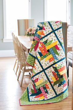 "This is a fun quilt to make use of bright printed 10"" squares. Designer Emily Bailey came up with the setting when playing with a variation of Delectable Mountain quilt blocks. Look for scrappy quilt patterns like Twisted Posies in Scrap Quilts Spring '15."