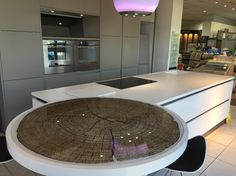 Really beautiful circular glass counter top with tree trunk image completed for Intoto kitchens showroom fitted into a white Corian top. Alternative breakfast bar or glass table top
