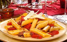 This sounds quite tasty with the two meats giving it interesting flavor notes. http://www.barilla.com/content/recipe/mostaccioli-tuscan-sauce