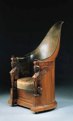"""An Empire period bergere of mahogany featuring terminal sphinxes. A similar chair appears in the painting """"Les Licteurs rapport Brutus lses corps ses fils"""" by David, 1789. $189,279."""