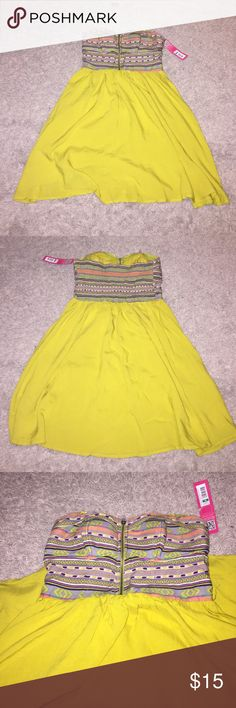 NWT Bandeau dress Brand new, never worn. Lime green color with Aztec print on bandeau portion. Zipper down the middle that works. Perfect for the summer or even as a cover up for the beach! 100% rayon. No holes or stains. Xhilaration Dresses Strapless