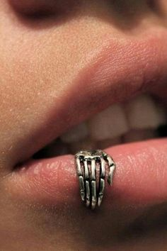 I want this if i ever do get my lip pierced. skeleton lip ring