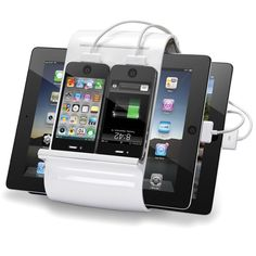 We need A few of these in our house!!   The Four iPhone/iPad Charging Hub - Hammacher Schlemmer