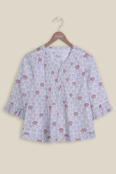 A lightweight, casual blouse woven from 100% cotton. Our Sweetie Antiquey Blouse truly has a sweet print with natural tonal colours combined throughout. The elegant blouse features pintuck detailing, secured with pearl buttons, finishing with frilled detailing on the bottom of the blouse and 3/4 length sleeves. The perfect blouse for the warmer weather.