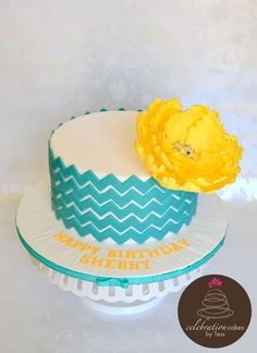 Teal Chevron Cake with Yellow Flower