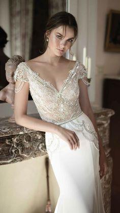 Incredible embellished V-neckline bodice wedding dress with sleek white skirt; Featured Dress: Alon Livne                                                                                                                                                                                 More