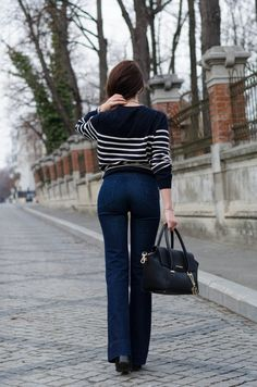 www.cristinafeather.com   Wearing a Trussardi Bag / Mango flared jeans / H&M Stripes Sweater