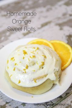 Homemade Orange Sweet Rolls with Cream Cheese Frosting.
