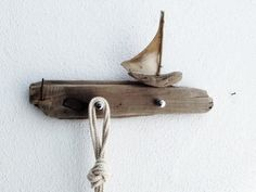 "maritime key rack /coat rack ""Sailboat""  made from natural driftwood and genuine goatskin parchment...one of a kind beach house decoration. $89.90, via Etsy."