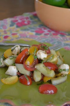 Tossed caprese salad. tomato, mozzarella, basil + cucumbers for fun.