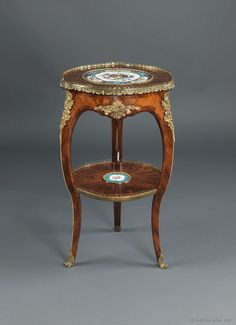 A Kingwood and Gilt-Bronze Mounted Table Ambulante with Sèvres Style Porcelain Plaques. French, Circa 1860.
