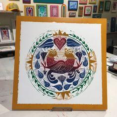 Linoleum block print mounted to wood