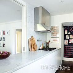 Bright White Kitchen | Designer: Sally Armstrong | Photographer: Virginia MacDonald | #kitchen #interiordesign #kitchendesign #marble #kitchenbacksplash #carreramarble