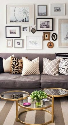 Mix of pillows - traditional living room with gallery wall art gold tables gray sofa