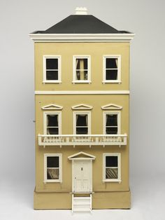 The Drew House was made in the early 1860's, said to be manufactured from orange boxes, yet beautifully furnished with items from an important German doll's house furniture maker - Schneegas of Waltershausen.