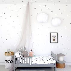 """My ""Lucy the Deer"" art print nestled in this cozy dreamy princess room! And how do you like my DIY canopy from fabric that I bought in downtown LA for 4$!!!! All you need is a hook in a ceiling And hang the @electriccrowns lights. Best quality bedding from #nattinatti, toys storage bag from #tellkiddo, little star pillow from #thelandofnod, #heico mushroom lamp from #thismodernlife, star wall decals from @ohongsdesignstudio, gorgeous flamingo from #growingfootprints by #vanessabyrne,"