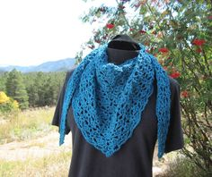 A quick lacy shawlette that can be worn around the shoulders or snuggled up around the neck as a cozy warm layer with a coat