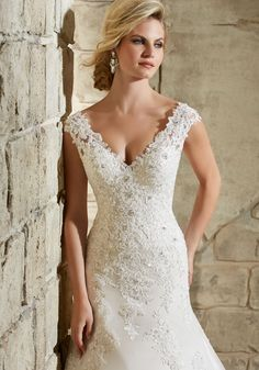 Wedding Dresses and Bridal Gowns by Morilee designed by Madeline Gardner. Lace Appliques on Net with Crystal Beading and Scalloped Hemline Over Soft Satin