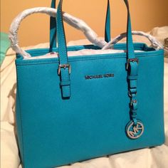 """Michael Kors jet set medium tote JET SET MEDIUM SAFFIANO LEATHER TOTE-TILE BLUE  with silver detail -Top Handle: 5""""  -Adjustable Strap: 20-22""""  -Interior: One Zip Divider Pocket, One Zip Pocket, Three Open Pockets, One Cell Phone Pocket, One Key Fob  -12 X 9 X 5  -Dog Clip -100% Polyester Lining.  ❌NO TRADES❌ Michael Kors Bags Totes"""