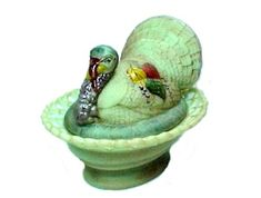 Limited Edition Green Glass Turkey Covered Animal Dish. Turkey shape, base is pedestal style with a Lace Rim.  Lime Green with Satin Finish, Air Brushed with bits of brown to accent the feathers and texture of the nest, with Hand Painted head plus leaves on his back. American made in U.S.A.