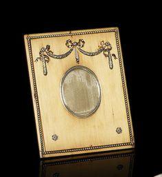 A silver-mounted wooden frame Fabergé, circa 1900
