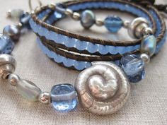 Denim Blue fine silver shell beaded coastal bracelet paired with double wrap leather bracelet.