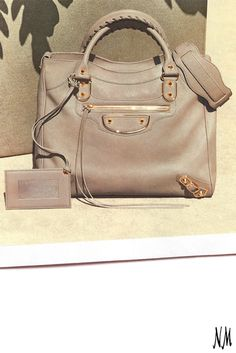 d098411096a Add a touch of gold to your everyday look. Pair this versatile Balenciaga  bag with