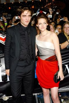 Later, at the official premiere of the first Twilight film, Stewart appeared on co-star Robert Pattinson's arm in an off-the-shoulder color-blocked minidress. It was a look she'd go on to repeat at other major events. The updo, however, is a rare occurrence.