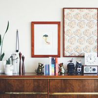 dresser/sideboard with art and knickknacks