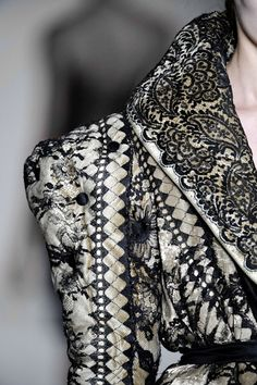 Beautiful sleeve and collar detail... wish i could see the rest of the coat