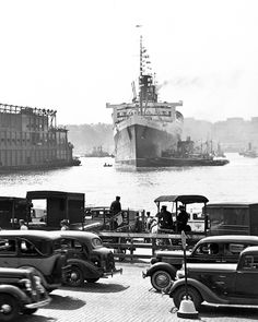 """route22ny: """"The Queen Mary docks at West Side Piers, Manhattan, on its 1936 maiden voyage. Photo from H.A. Dunne & Co. """""""