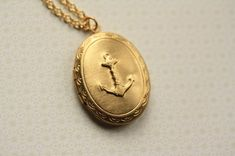 Simple Sailor Locket, Long Embossed Anchor, Pendant, Vintage Textured Backside, Oval Jewelry, Long Chain. $25.00, via Etsy.