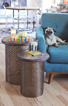 Aluminum sheet metal + pine round + spraypaint = A super stylish DIY sidetable! Click through for the full how-to.