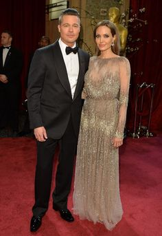 Brad Pitt and Angelina Jolie shimmer at the Oscars in 2014