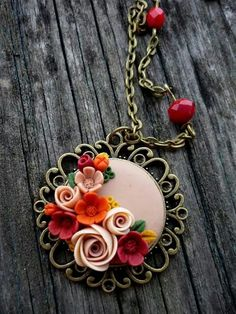 Cute flower necklace made with polymer clay Polymer Beads, Polymer Clay Flowers, Polymer Clay Necklace, Polymer Clay Crafts, Fimo Clay, Clay Beads, Polymer Clay Pendant, Polymer Clay Creations, Polymer Clay Embroidery