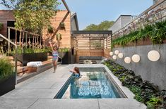 This contemporary backyard in Chicago boasts many materials (concrete, wood, steel), a rectangular pool, built-in seating under a simple wood pergola, airy flowers anchored in a steel housing adjacent to the steps, and the list goes on... #modernbackyard #contemporarybackyard #landscapedesign #landscapearchitecture