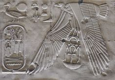 'Nekhbet in Nefertem-Ptah-Sokar Hall at Abydos'.  The vulture goddess Nekhbet is flapping her wings in this relief detail on the north wall of the Nefertem-Ptah-Sokar Hall in the Seti I Temple at Abydos.