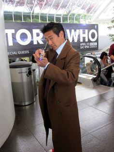 This is Grant Imahara from Mythbusters.  He's dressed as the Doctor. My little geek mind...blown.