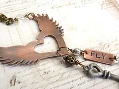 Steampunk copper necklace with flying wings and heart pendant