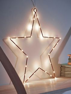 This pretty, delicate light has a copper coloured frame with wired LED bulbs. Perfect for adding a warm touch of sparkle to any room, it can be propped on a shelf or has a loop for hanging.