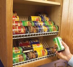 The easiest can food rotating racks to make yourself are taking wire closet racks and turning them upside down and mounting them at an angle.