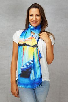 LIKE, BUY, WEAR, LOVE  This is a stunning long scarf in a burst of amazing colours and style, showing a wonderful impressionist painting. On one side it is the beautiful painting and on the other side is white silk from the best quality achievable. The scarf is a perfect idea for any woman. It can be around the neck in one long circle, can be wrapped twice or can be worn in any other pleasing way. Perfect accessory for all seasons. Its large size allows for multiple pleasurable options meant…