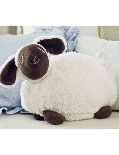 Warming Ewe - Have you hugged a cute little lamb lately? Heat this soft, floppy sheep's removable insert briefly in the microwave and use it to warm cold bed sheets or relax busy minds before sleep.