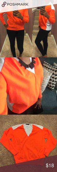 •J. Crew Color Block Sweater• Neon orange color block sweater only worn a few times and in excellent condition. I'm not sure of fabric since since I cut off the garment tags. J. Crew Sweaters V-Necks