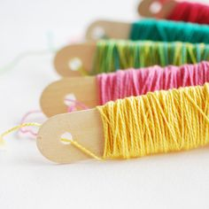 A Storage Solution for Pearl Cotton, Tutorial...she shows how to do this using craft sticks. This is brilliant!