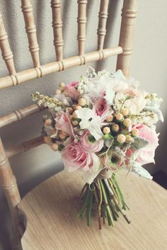 Imbue Weddings bouquet in pink, peach and grey with roses, ranunculus, berries and dusty miller.